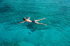 Young man snorkeling in blue sea Stock Images