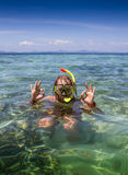 Young man snorkeling in clear shallow tropical sea Stock Photography
