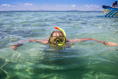 Young man snorkeling in clear shallow tropical sea Stock Photo