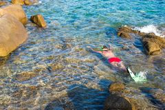 Young man snorkeling in clear tropical turquoise Royalty Free Stock Image