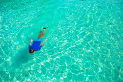 Young man snorkeling in clear tropical turquoise Stock Image