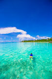 Young man snorkeling in clear tropical turquoise Stock Photos