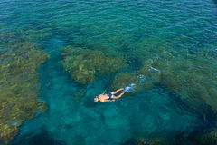 Young man snorkeling in transparent shallow ocean. Canary Islands, Lanzarote, Charco del Palo, Spain royalty free stock photo