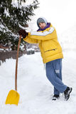 Young man with snow shove Royalty Free Stock Photo