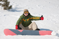 Young man with snowboard Stock Photos