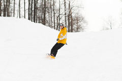 Young man on snowboard Royalty Free Stock Images