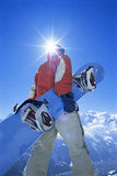 Young man with snowboard. Rear view of a young man with snowboard stock photo