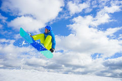 Young man on the snowboard Stock Photo