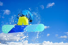Young man on the snowboard Stock Photography
