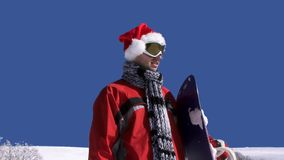 Young Man With Snowboard Looking For The Downhill stock footage