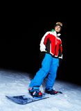 Young man on snowboard at night Royalty Free Stock Photography