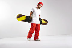 Young man with a snowboard in studio royalty free stock images