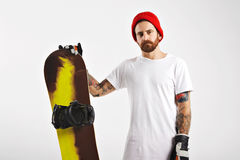 Young man with a snowboard in studio stock photos