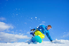 Young man on the snowboard Royalty Free Stock Image