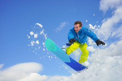 Young man on the snowboard Royalty Free Stock Photo