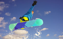 Young man on the snowboard Royalty Free Stock Images