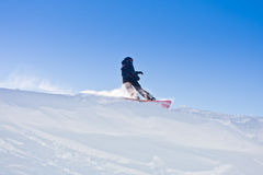 Young man snowboarding Royalty Free Stock Images