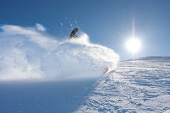 Young man snowboarding Stock Photo