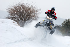 Young man on snowmobile jumping Royalty Free Stock Image