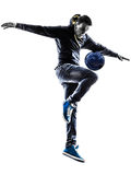Young man soccer freestyler player silhouette Stock Images