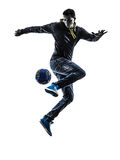 Young man soccer freestyler player silhouette Stock Photos