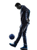 Young man soccer freestyler player silhouette Stock Image