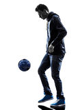 Young man soccer freestyler player silhouette Royalty Free Stock Image