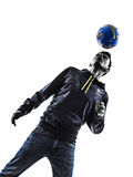 Young man soccer frestyler player silhouette Stock Image