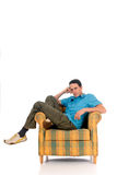 Young man sofa Stock Images