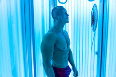Young Man At Solarium In Beauty Salon Royalty Free Stock Photos