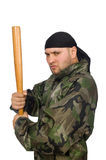 Young man in soldier uniform holding bludgeon Royalty Free Stock Image