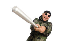 Young man in soldier uniform holding bludgeon Royalty Free Stock Photography