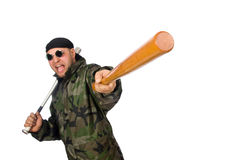 Young man in soldier uniform holding bludgeon Royalty Free Stock Photo