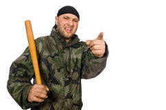 Young man in soldier uniform holding bludgeon Stock Photography