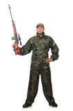 Young man in soldier uniform holding gun isolated Royalty Free Stock Image