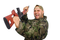 Young man in soldier uniform holding gun isolated Stock Images