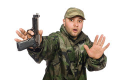 Young man in soldier uniform holding gun Stock Photography