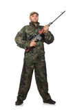 Young man in soldier uniform holding gun Stock Photo