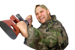 Young man in soldier uniform holding gun isolated Stock Photography