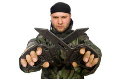 Young man in soldier uniform holding knife Stock Photo