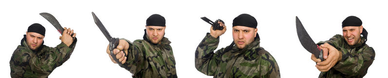 The young man in soldier uniform holding knife isolated on white Royalty Free Stock Photo