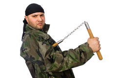 Young man in soldier uniform holding nunchaks Royalty Free Stock Photo