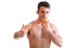 Young man with some fresh red apple isolated. On white Stock Photo