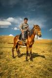 Young man in Son Kol in Kyrgyzstan Stock Photos