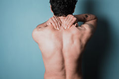 Young man with sore neck Royalty Free Stock Photo