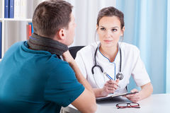 Young man with sore throat in clinic. Young men with strong sore throat on visit in medical clinic Royalty Free Stock Image