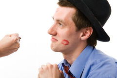 The young man is sorry. Trace of a kiss on a cheek Royalty Free Stock Photo