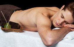 Young man in spa massage salon. Young man relaxing at the spa ready to get a massage Stock Photo