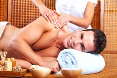 Young man in Spa massage salon. Royalty Free Stock Photos