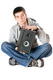 Young man with a speaker Royalty Free Stock Photo